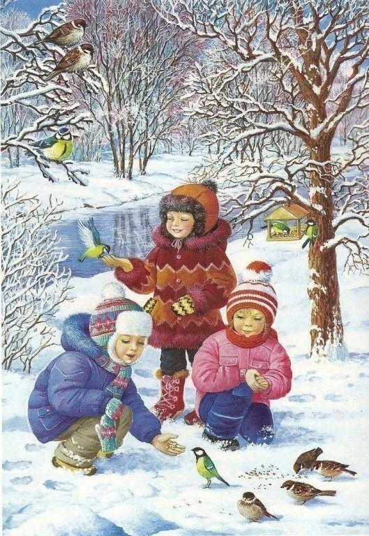 Дети кормят птиц на улице