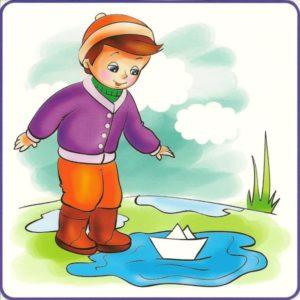 Мальчик запускает кораблик